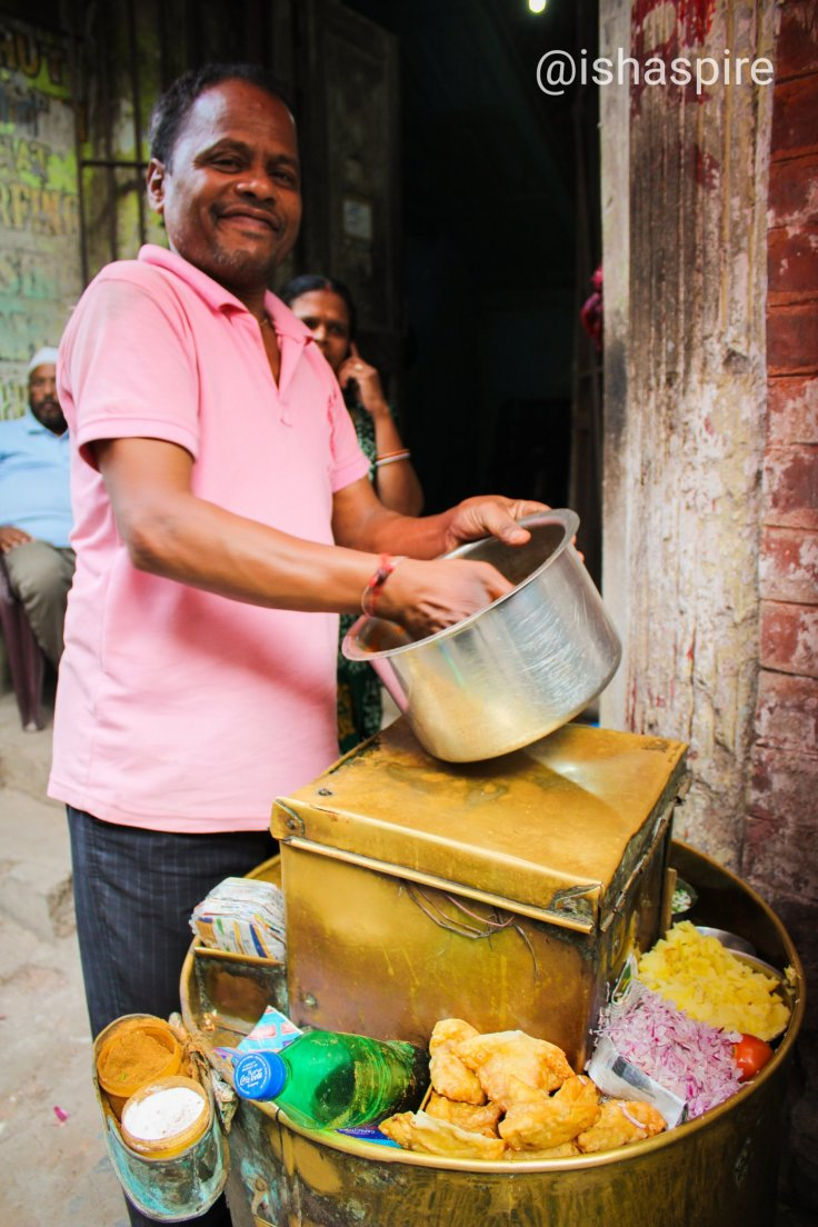 Sharad, a hawker in Kolkata's Ezra street who makes a living selling a popular Bengali snack